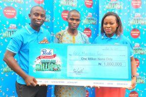 L -R: Junior Brand Manager Peak, FrieslandCampina WAMCO Nigeria Plc, Mr. Adetunji Quadri, 1million Naira Winner of the Peak Reach for Millions Promo, Raji Muideen Taiwo, and Senior Brand Manager Peak, Mrs. Omolara Banjoko, at the Peak Reach for Millions Promo Prize Presentation in Lagos