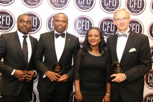 l-r:  Publisher Instinct Business/ Organiser of the Chief Finance Officer (CFO) Award, Mr. Akin Naphtal; Group Chief Finance Officer, UBA Plc and  recipient of  CFO of the year, 2015 Banking category,  Mr. Ugo Nwaghodoh; Group Editor, Instinct Business, Mrs. Kehinde Olesin; and  Group Chief Finance Officer, Jagal Group, Mr. Richard E. Turner at the maiden edition of the CFO awards held in Lagos