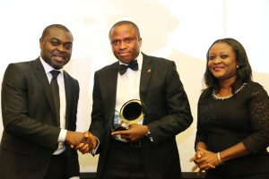 l-r:  Publisher, Instinct Business /Organiser of the Chief Finance Officer (CFO) Award, Mr. Akin Naphtal ;  Group Chief Finance Officer, UBA Plc and  recipient of  CFO of the year, 2015 Banking category,  Mr. Ugo Nwaghodoh; and Group Editor, Instinct Business, Mrs. Kehinde Olesin, at the maiden edition of the CFO awards held in Lagos