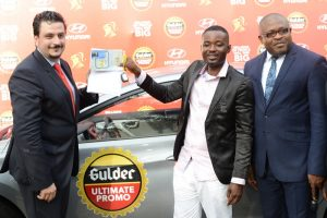 Marketing Director Nigerian Breweries Plc Franco Maria Maggi (left), presenting keys and vehicle documents to Francis Njoku, winner of a brand new Huyndai Elantra car at a raffle draw in the ongoing Gulder Ultimate Promo, with them is Kufre Ekanem, Corporate Affairs Adviser, also of Nigerian Breweries Plc at the presentation ceremony at NB headquarters in Lagos recently.