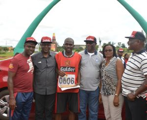 L – R: Emmanuel Agu, Marketing Manager, Gulder, More, 33, Life and Stout category; Ansel Alokha, Zonal Business Manager, East, both of Nigerian Breweries Plc.; Chinedu Odimgbe, winner of a brand new Hyundai Elantra car of 'The Chase' leg of the 2015 edition of the Gulder Ultimate Promo; Obiora Okoli, Regional Business Manager; Ethel Emma-Uche, Brewery Manager, Ama Breweries and Patrick Ejodoh, Public Affairs Manager – East, all of Nigerian Breweries Plc., during the presentation of prizes, at Michael Okpara Square, Enugu,