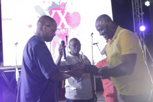 Dr. Dele Ajayi presenting the long standing client award to MTN's representative