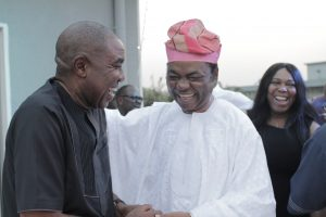 Mr Hubert Eze Commercial Director Nigerian Breweries chatting with Mr Bola Akingbade at the party