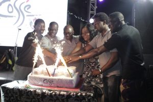 The Cosse Team cutting the anniversary cake