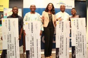 "L-R: Lucky Winners of N100, 000, (GSM Engineer), Joseph Sunday Oluwole; N1Million ( Executive Driver), Abdulwahab Ajao Aliu; Head, Retail Banking, Skye Bank Plc, Nkolika Okoli; N1Million ( Business Man), Okuzu Vincent Chinedu and N250, 000 (a Student of Moshood Abiola Polytechnic), Salako Doyinsola Kafilat at the seventh cheque presentation to winners in the ongoing Skye Bank's ""Reach for the Skye"" Millionaire Reward Scheme held in Lagos recently"