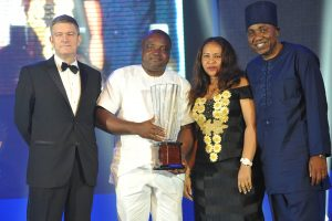 FroM Left to Right – Mr. Nicolaas Velvede, Managing Director Nigerian Breweries; Mr. Ken Maduakor,  Nigerian Breweries; NB Plc Distributor of the Year; wife of the winner, Mrs. Maduakor and Mr. Hubert Eze, Sales Drirector, Nigerian Breweries at the Distributors Award Night in Lagos on Friday