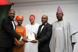 : Prof. Pat Utomi (3rd Left) and Elder (Mrs) Inyang Anya( 2nd Left) presenting the Zik Award for Professional Leadership to Biodun Shobanjo represented by his sons Tunde Shobanjo(1st Left) and Olufemi Shobanjo (4th Left) with Ogun State Governor, HE Ibikunle Amosun looking on during the 2015 Annual Zik Prize Awards at the Civic Centre, Victoria Island, recently- 789marketing