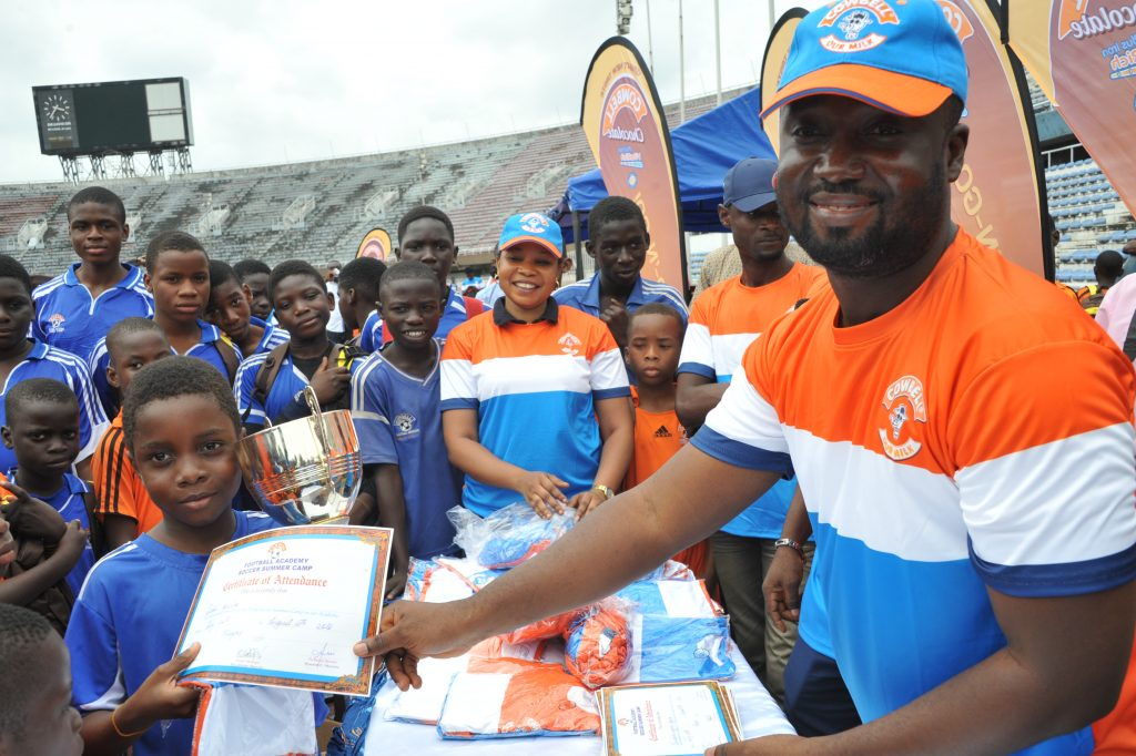 Abiodun Ayodeji, Category Manager, Dairy, Promasidor Nigeria Limited, presenting Certificate of Participation to Judah Bajela, CFA Under 10 team captain, at the grand finale of the CFA 2016 SUMMER CAMP at the Main Bowl of the National Stadium, Surulere on Saturday, August 13th. - 789marketing