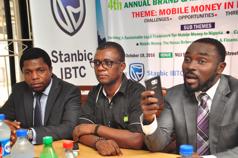 """L-R: Melvin Awolowo, acting communication manager, Stanbic IBTC; Goddie Ofose, chairman, Brand Journalists' Association of Nigeria (BJAN), and Bennet Frimpong, marketing manager, personal and business banking, Stanbic IBTC, at the press conference to announce the 4th annual brand & marketing conference with the theme """" Mobile Money in Nigeria"""" held in Lagos - 789marketing"""