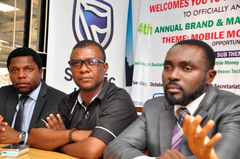 """L-R: Melvin Awolowo, acting communication manager, Stanbic IBTC; Goddie Ofose, chairman, Brand Journalists' Association of Nigeria (BJAN), and Bennet Frimpong, marketing manager, personal and business banking, Stanbic IBTC, at the press conference to announce the 4th annual brand & marketing conference with the theme """" Mobile Money in Nigeria"""" held in Lagos. PHOTO;AKEEM SALAU - 789markerting"""