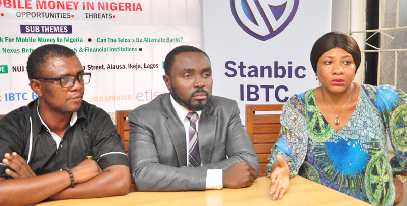 """Mr Goddie Ofose, chairman, Brand Journalists' Association of Nigeria (BJAN);Bennet Frimpong, marketing manager, personal and business banking, Stanbic IBTC,and Ms Clara Okoro,Vice Chairman Brand Journalist Association of Nigeria[BJAN]. at the press conference to announce the 4th annual brand & marketing conference with the theme """" Mobile Money in Nigeria"""" held in Lagos.PHOTO;AKEEM SALAU - 789marketing"""