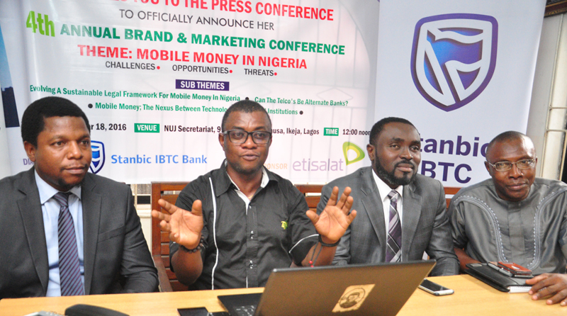"""L-R;Mr Melvin Awolowo, acting communication manager, Stanbic IBTC;Mr Goddie Ofose, chairman, Brand Journalists' Association of Nigeria (BJAN);Bennet Frimpong, marketing manager, personal and business banking, Stanbic IBTC and Mr Princewill Ekwujuru,Former Vice Chairman BJAN. at the press conference to announce the 4th annual brand & marketing conference with the theme """" Mobile Money in Nigeria"""" held in Lagos.PHOTO;AKEEM SALAU - 789marketing"""